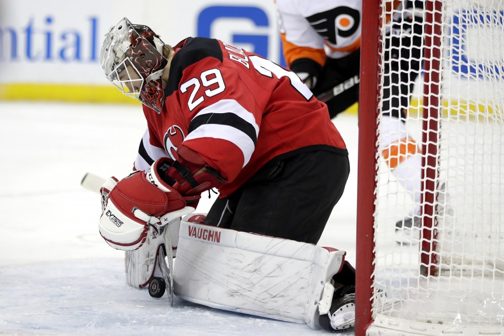 New Jersey Devils goaltender MacKenzie Blackwood blocks a shot from the Philadelphia Flyers during the first period of an NHL hockey game, Saturday, J