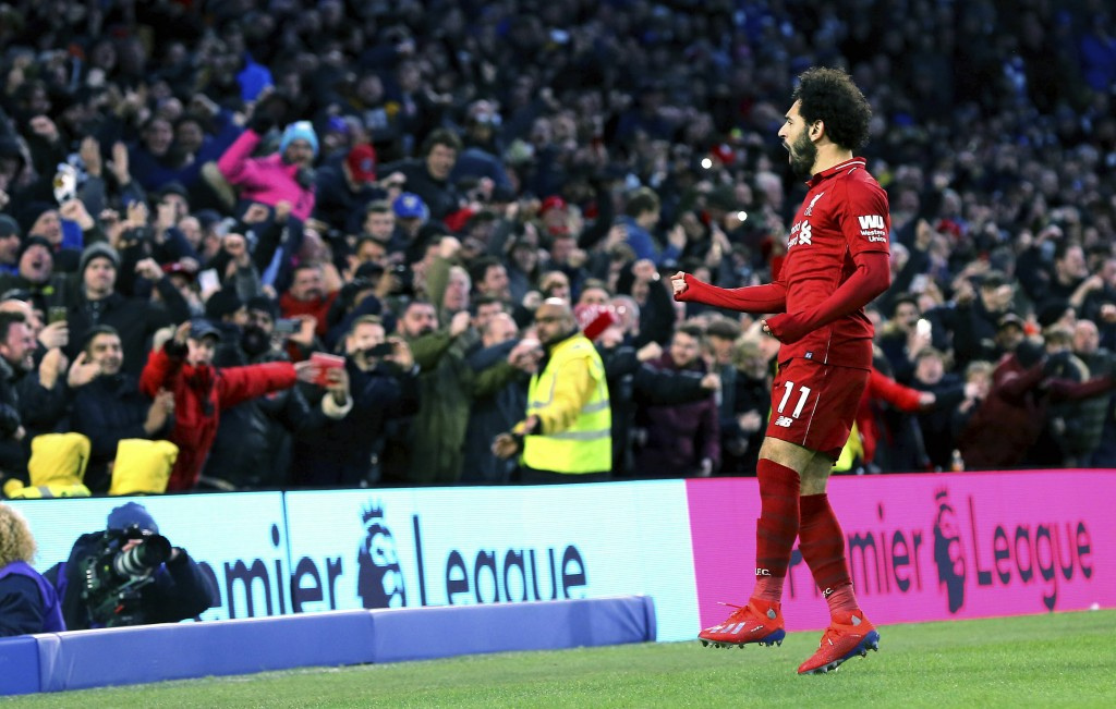 Liverpool's Mohamed Salah celebrates scoring his side's first goal of the game during the English Premier League soccer match between Brighton and Hov