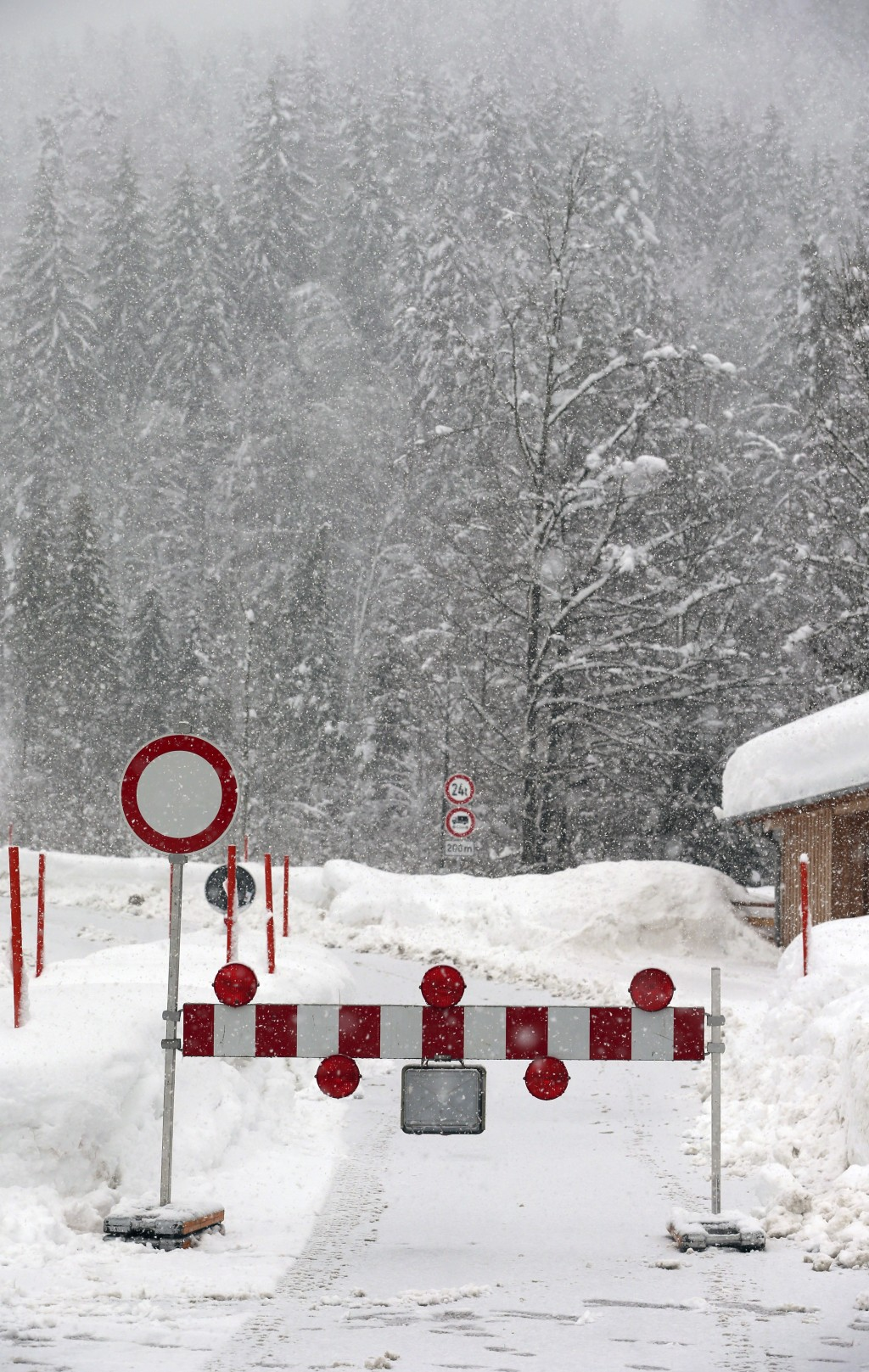 Due to the danger of an avalanche a mountain pass road is closed in Obermaiselstein, Germany, Sunday, Jan. 13, 2019. (Karl-Josef Hildenbrand/dpa via A