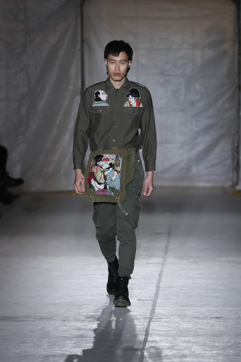 A model wears a creation as part of the John Richmond men's Fall-Winter 2019-20 collection, that was presented in Milan, Italy, Sunday, Jan.13, 2019.