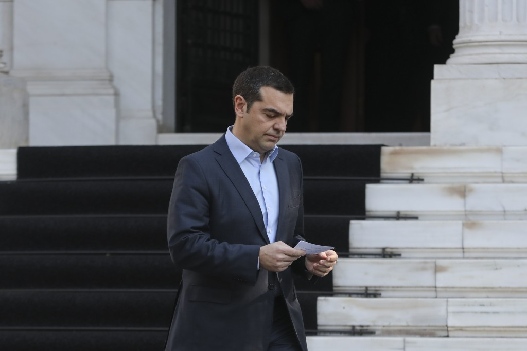 Greece's Prime Minister Alexis Tsipras, arrives to make a statement following the resignation of Defense Minister Panos Kammenos, in Athens, Sunday, J
