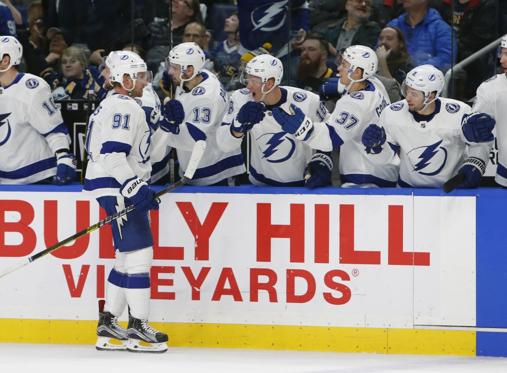 Tampa Bay Lightning forward Steven Stamkos (91) is congratulated for his goal during the third period of an NHL hockey game against the Buffalo Sabres...