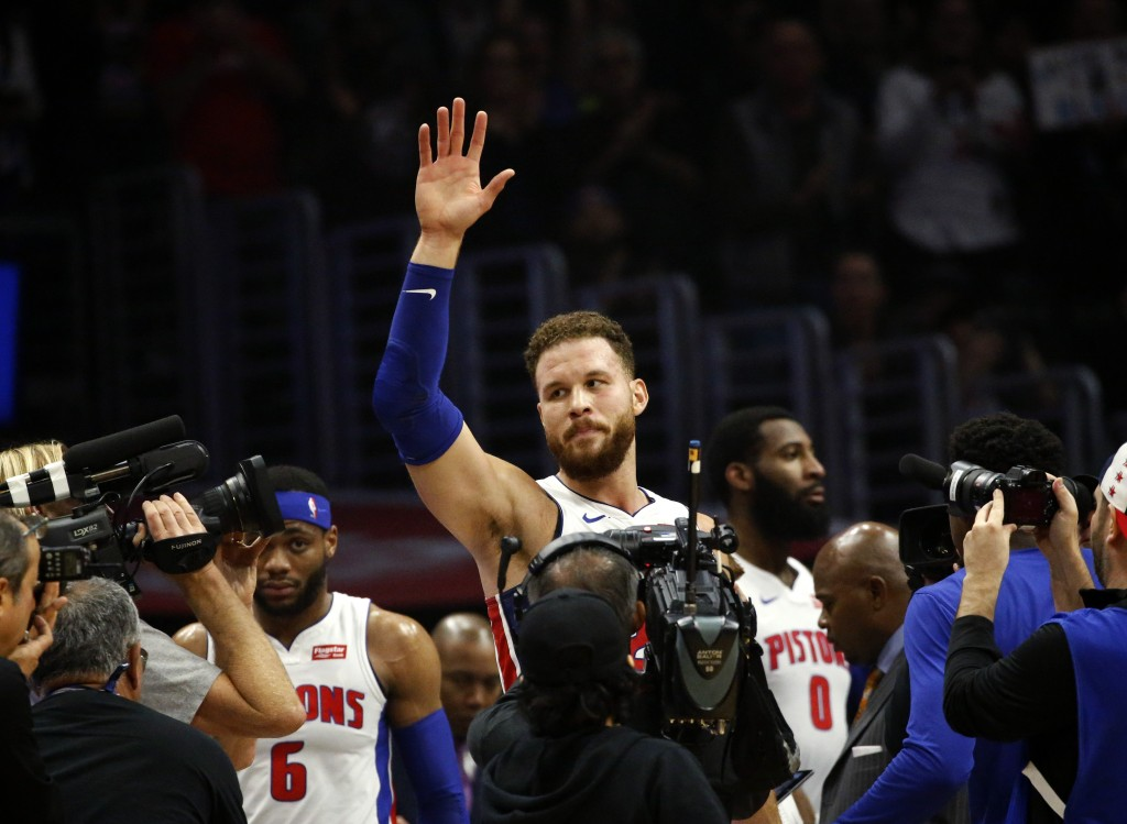 Detroit Pistons' Blake Griffin waves to fans during the first half of an NBA basketball game against the Los Angeles Clippers, Saturday, Jan. 12, 2019