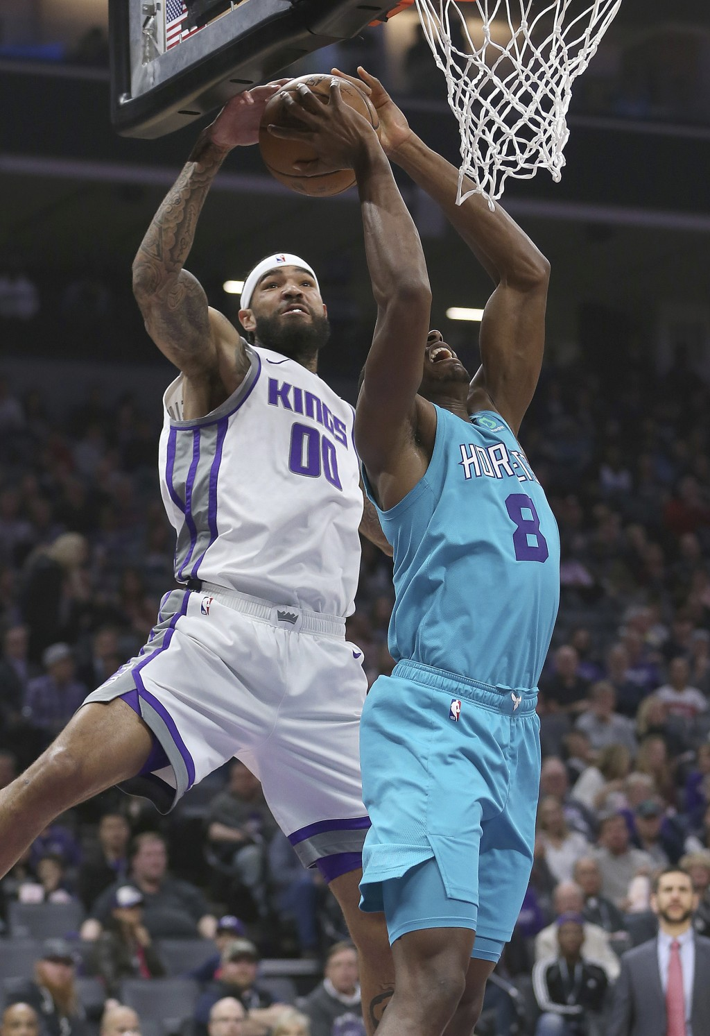 Charlotte Hornets center Bismack Biyombo, right, has his shot blocked by Sacramento Kings center Willie Cauley-Stein during the first quarter of an NB