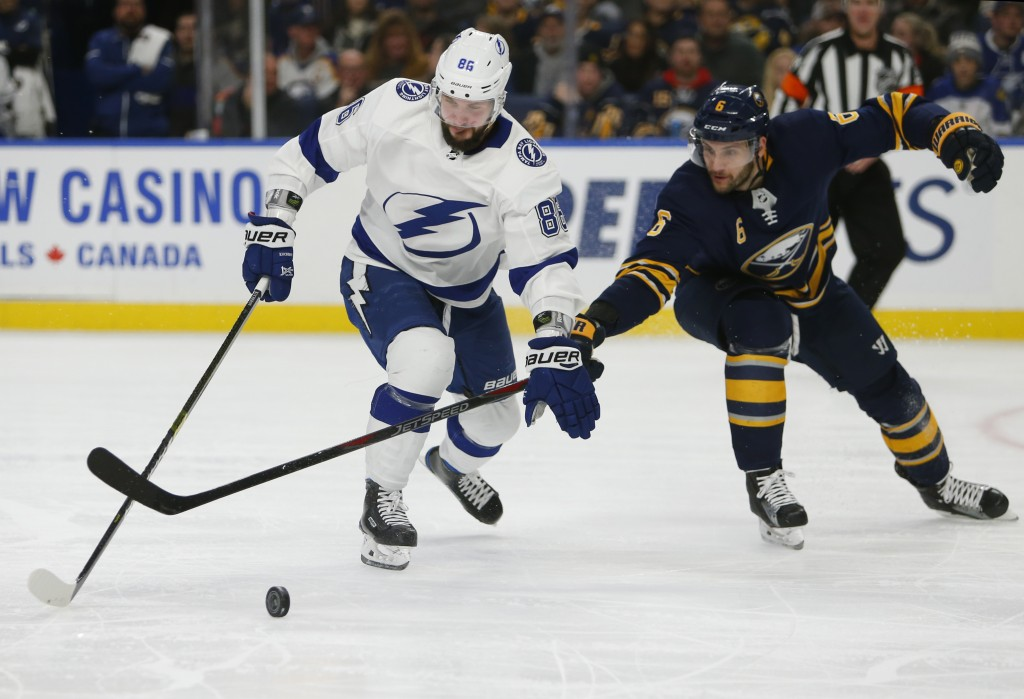 Buffalo Sabres defenseman Marco Scandella (6) stick checks Tampa Bay Lightning Nikita Kucherov (86) during the second period of an NHL hockey game, Sa
