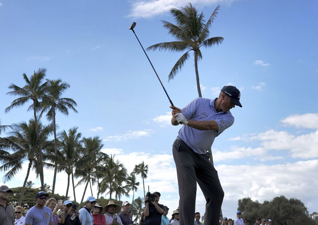 Matt Kuchar hits from the 13th tee during the third round of the Sony Open golf tournament Saturday, Jan. 12, 2019, at Waialae Country Club in Honolul
