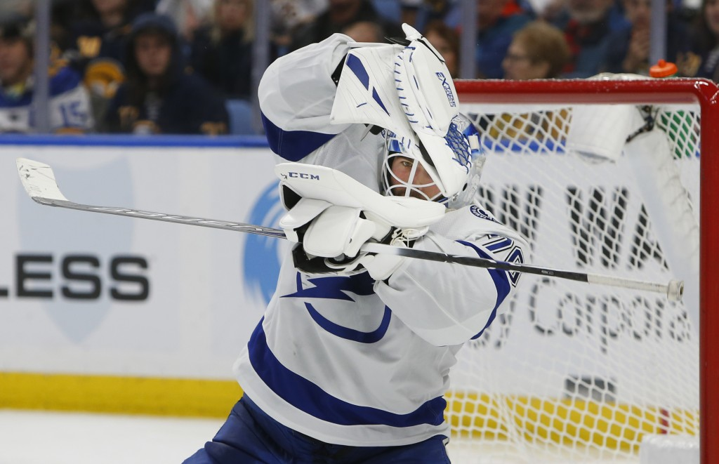 Tampa Bay Lightning goalie Louis Domingue makes a glove save during the third period of the team's NHL hockey game against the Buffalo Sabres, Saturda