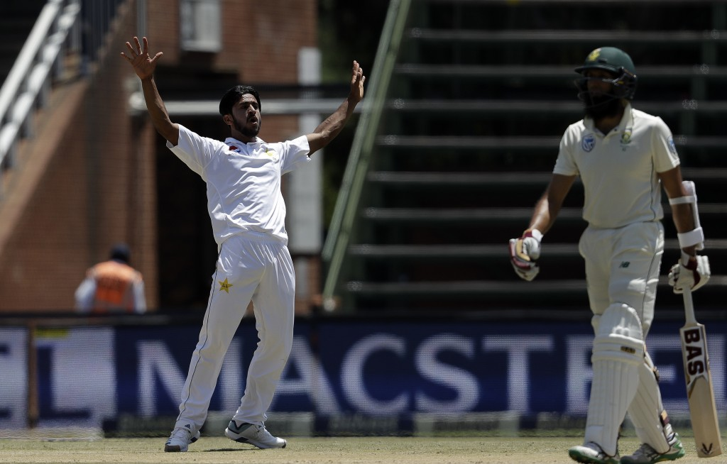 Pakistan's bowler Hasan Ali, left, celebrates after dismissing South Africa's batsman Hashim Amla for 70 runs on day three of the third cricket test m