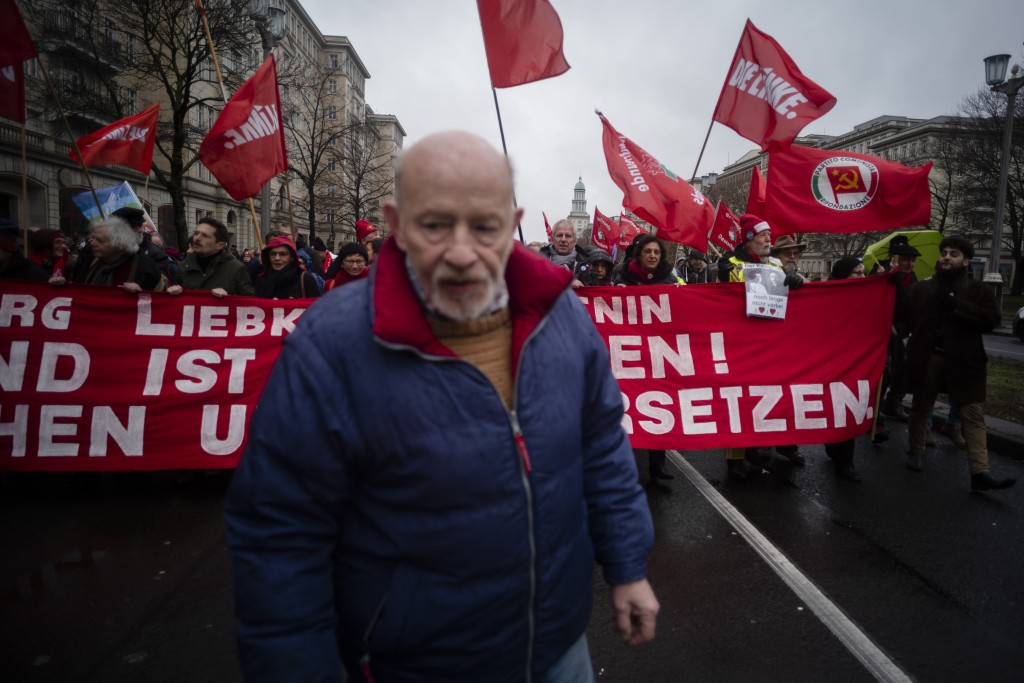 Protestors attend a demonstration of communist and socialist parties and groups in Berlin, Sunday, Jan. 13, 2019. The demonstration marks the 100th an