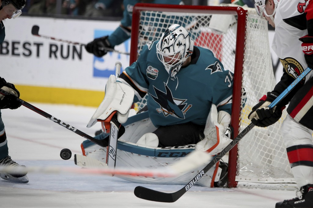 San Jose Sharks goaltender Martin Jones (31) blocks an Ottawa Senators shot during the second period of an NHL hockey game in San Jose, Calif., Saturd