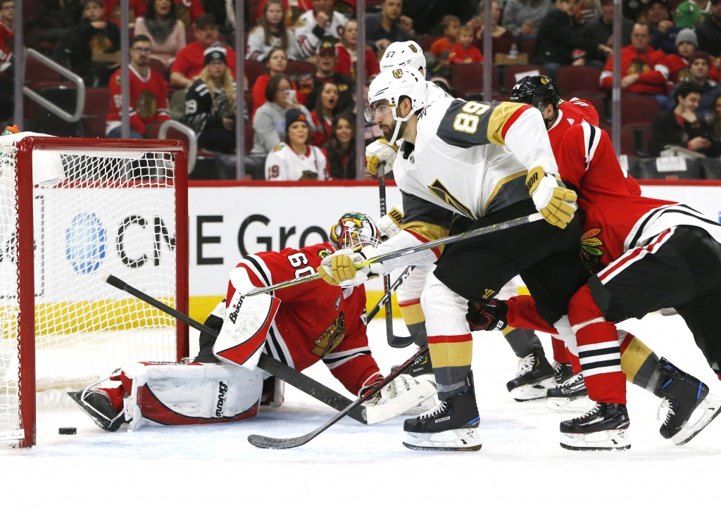 Vegas Golden Knights right wing Alex Tuch (89) scores a goal past Chicago Blackhawks goaltender Collin Delia (60) during the second period of an NHL h