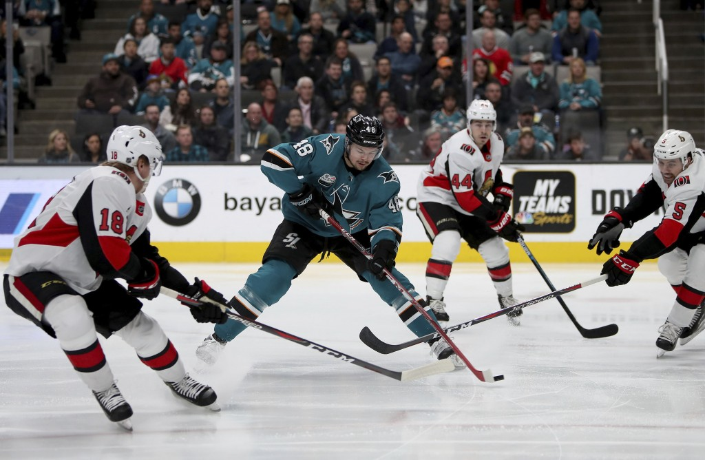 San Jose Sharks center Tomas Hertl (48) is pressured by the Ottawa Senators during the first period of an NHL hockey game in San Jose, Calif., Saturda
