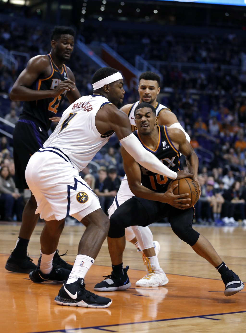 Denver Nuggets forward Paul Millsap (4) and Phoenix Suns guard De'Anthony Melton (14) vie for the ball during the second half during an NBA basketball