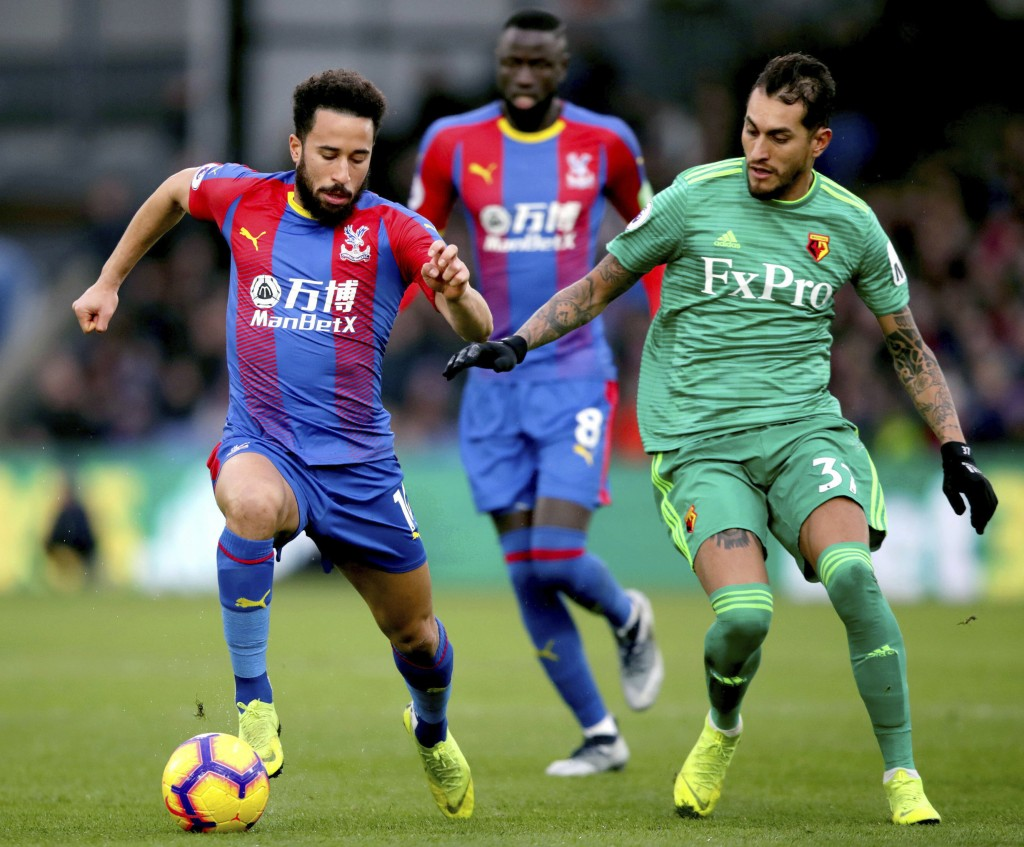 Crystal Palace's Andros Townsend, left, and Watford's Roberto Pereyra compete for the ball during the English Premier League soccer match between Crys...