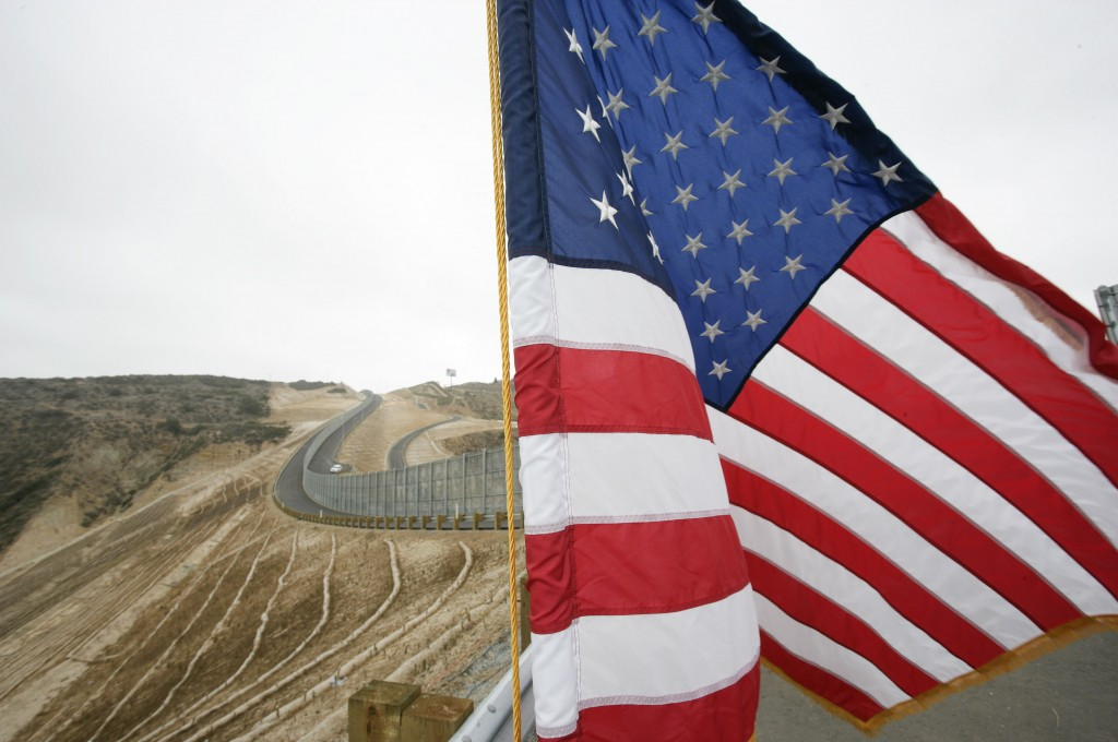 FILE - In this July 6, 2009 file photo, an American flag flies during a ceremony held in front of the completed Smuggler's Gulch project along the U.S