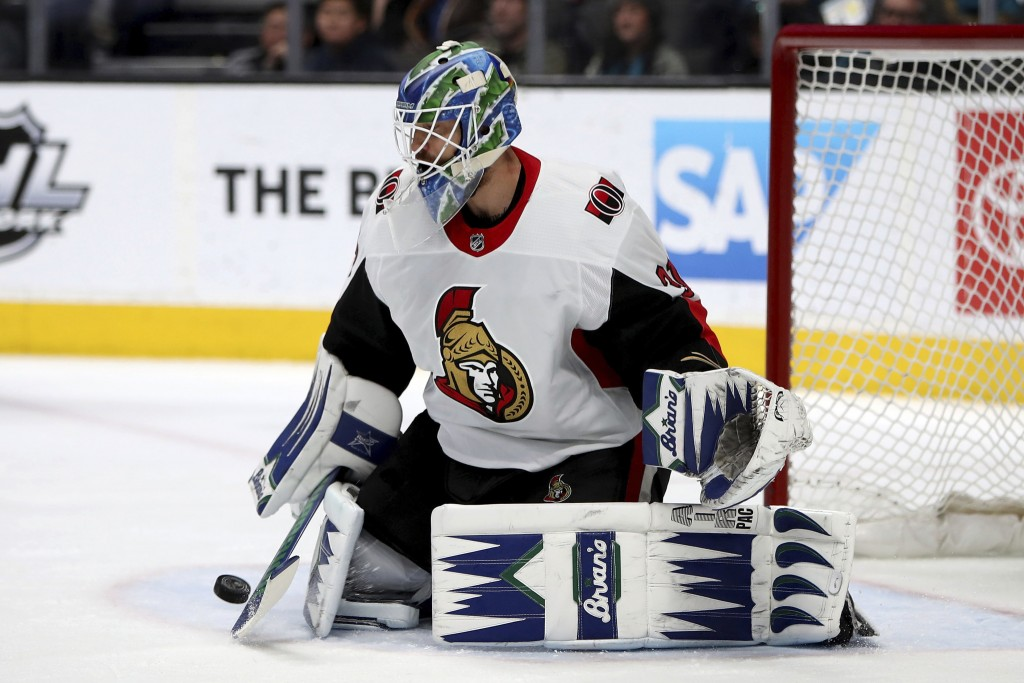 Ottawa Senators goaltender Anders Nilsson stops a shot on goal by the San Jose Sharks during the first period of an NHL hockey game in San Jose, Calif