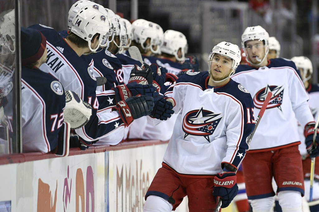 Columbus Blue Jackets right wing Cam Atkinson (13) celebrates his goal during the first period of an NHL hockey game against the Washington Capitals,