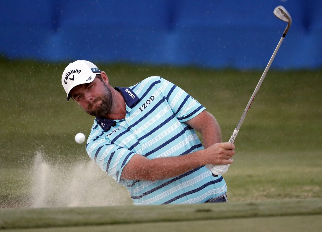 Marc Leishman hits from the 18th green bunker during the third round of the Sony Open PGA Tour golf event, Saturday, Jan. 12, 2019, at Waialae Country