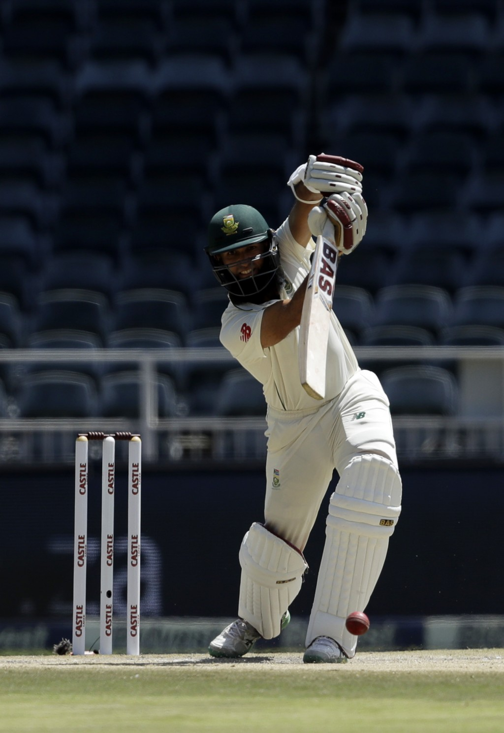 South Africa's batsman Hashim Amla plays a shot on day three of the third cricket test match between South Africa and Pakistan at the Wanderers stadiu