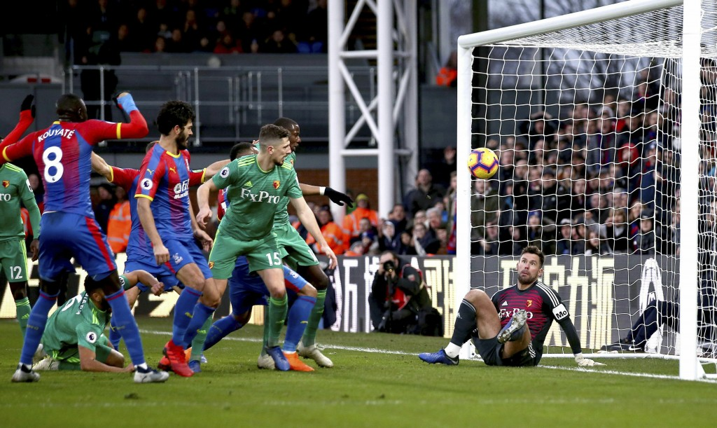 Watford goalkeeper Ben Foster, right, fails to make a save as team mate Craig Cathcart, center, scores an own goal during the English Premier League s...