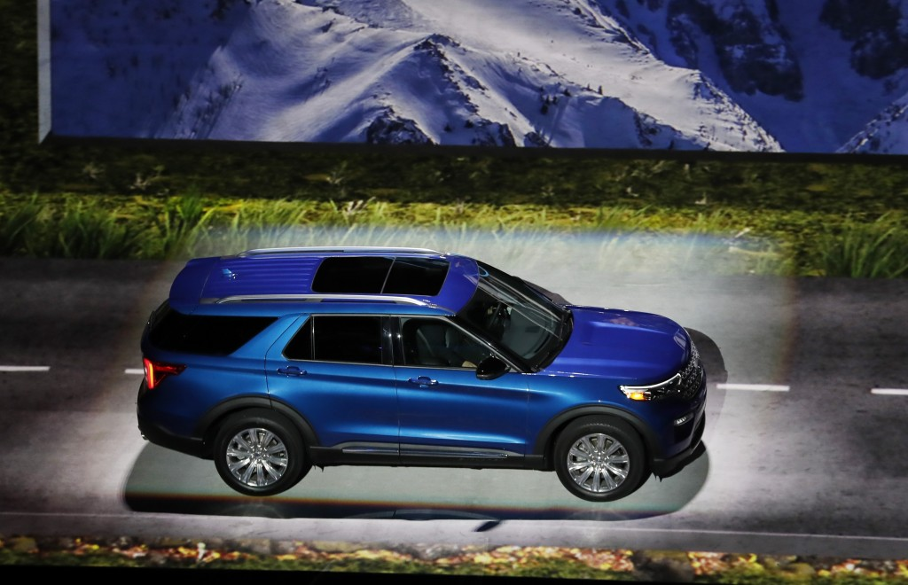FILE - In this Wednesday, Jan. 9, 2019 file photo, the 2020 Ford Explorer is unveiled, in Detroit. SUVs and a big pickup truck will get top billing at