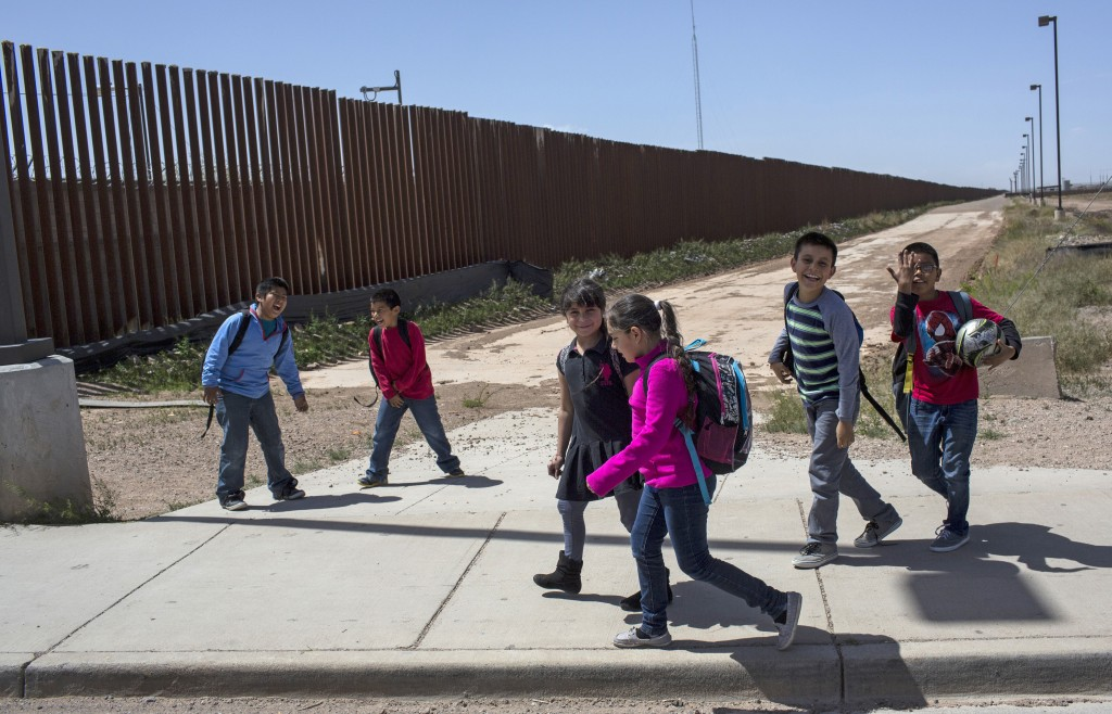 FILE - In this March 31, 2017 file photo, Columbus Elementary School students walk towards the U.S. port of entry on the border with Puerto Palomas, M