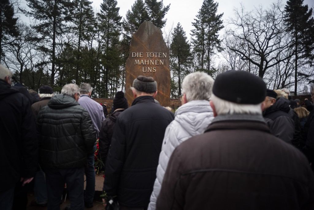 People line up to commemorate former German socialists' leaders Rosa Luxemburg and Karl Liebknecht on their graves at a cemetery Berlin, Sunday, Jan.