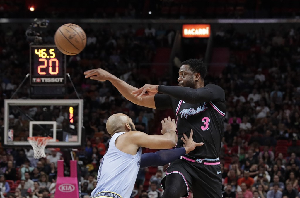 Miami Heat guard Dwyane Wade (3) passes the ball against Memphis Grizzlies guard Jevon Carter in the second half of an NBA basketball game Saturday, J...