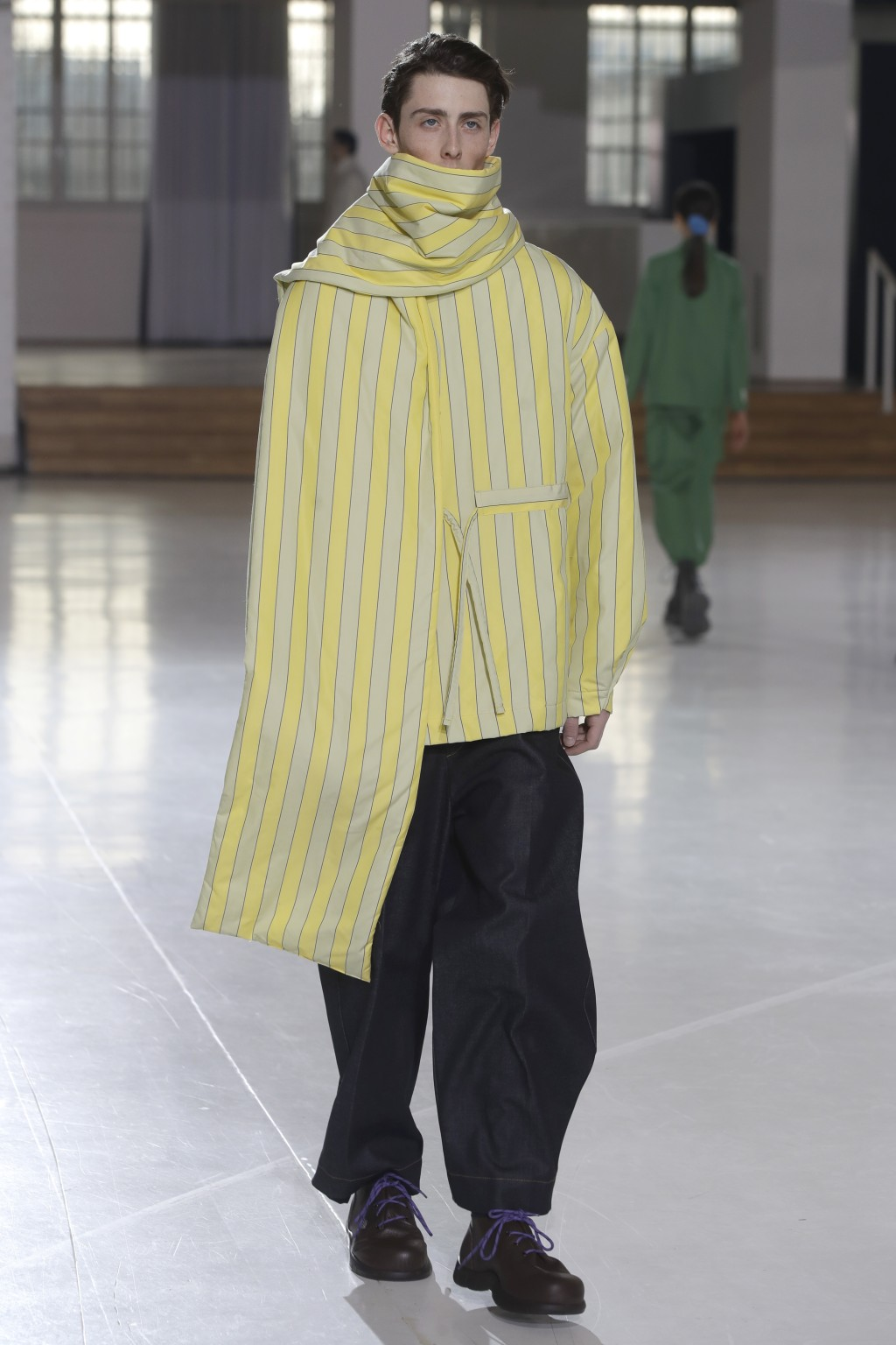 A model wears a creation as part of the Sunnei men's Fall-Winter 2019-20 collection, that was presented in Milan, Italy, Sunday, Jan.13, 2019. (AP Pho