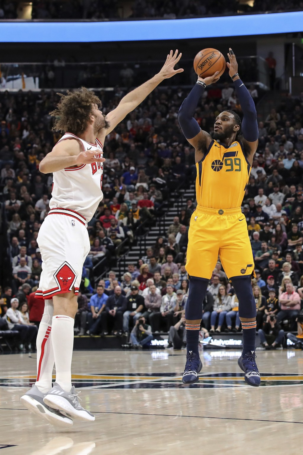 Utah Jazz forward Derrick Favors (15) shoots the ball over Chicago Bulls center Robin Lopez during the second quarter of an NBA basketball game Saturd...