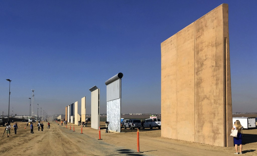 FILE- This Oct. 26, 2017 file photo shows prototypes of border walls in San Diego. President Donald Trump is not giving up on his demands for $5.7 bil