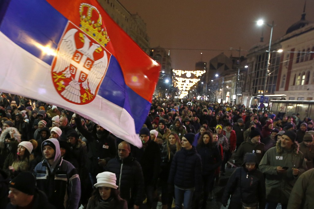 People march during a protest against populist President Aleksandar Vucic in Belgrade, Serbia, Saturday, Jan. 12, 2019. Critics accuse the president o