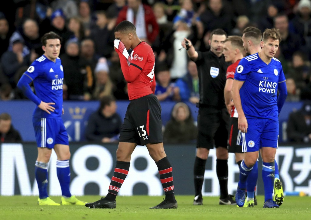 Southampton's Yan Valery, center, is sent off by Referee Michael Oliver during the English Premier League soccer match between Leicester City and Sout...