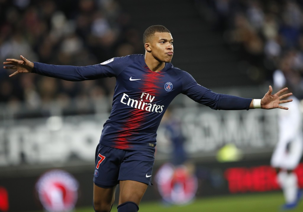 PSG's Kylian Mbappe celebrates after scoring his side's second goal during the French League One soccer match between Amiens and Paris-Saint-Germain a