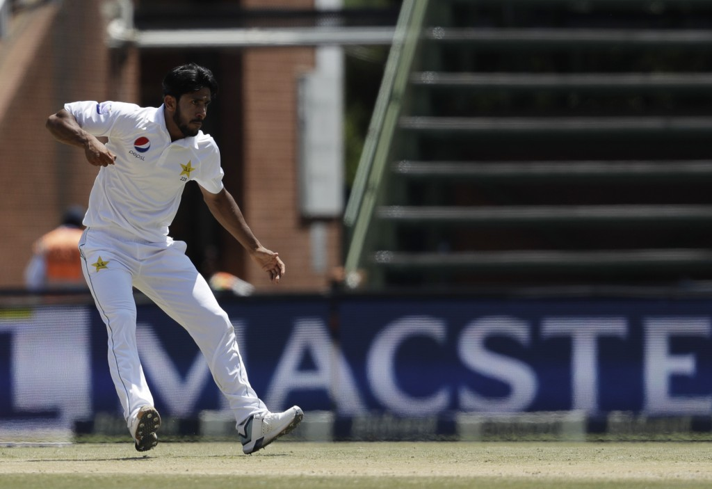 Pakistan's bowler Hasan Ali celebrates after dismissing South Africa's batsman Hashim Amla for 70 runs on day three of the third cricket test match be