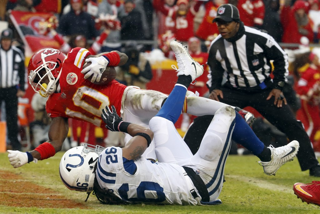 Kansas City Chiefs wide receiver Tyreek Hill (10) scores a touchdown past Indianapolis Colts safety Clayton Geathers (26) during the first half of an