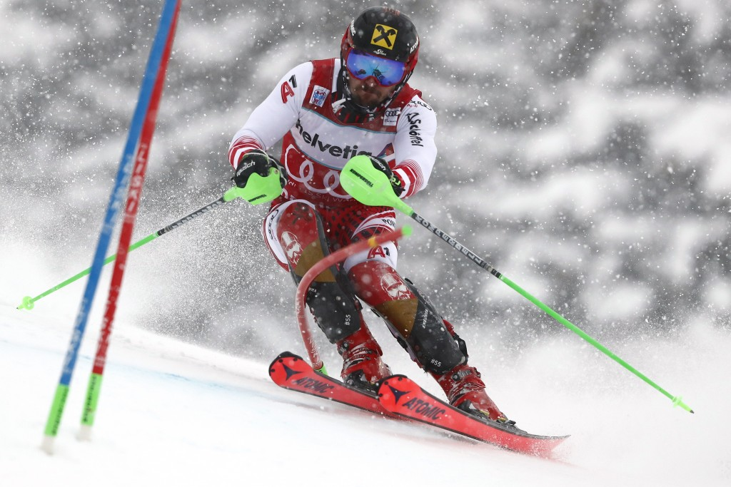 Austria's Marcel Hirscher competes during a ski World Cup men's slalom in Adelboden, Switzerland, Sunday, Jan. 13, 2019. (AP Photo/Gabriele Facciotti)