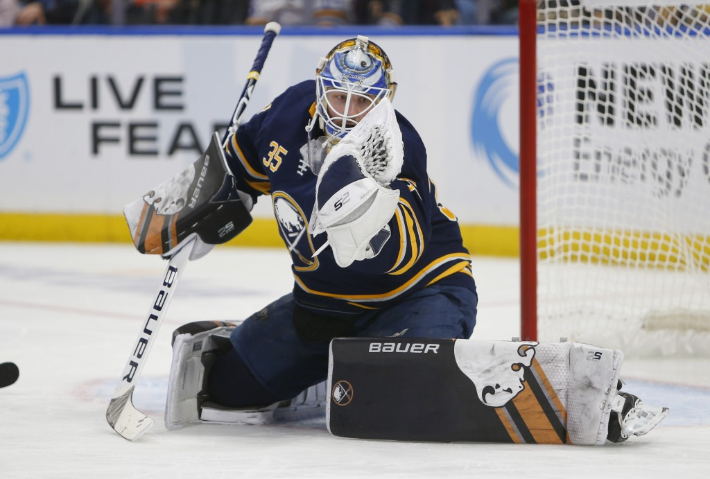 Buffalo Sabres goalie Linus Ullmark (35) makes a glove save during the second period of an NHL hockey game against the Tampa Bay Lightning, Saturday, ...