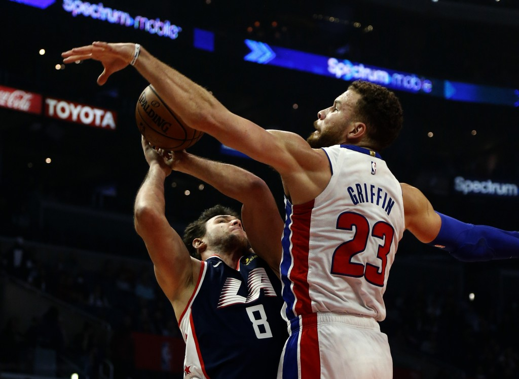 Detroit Pistons' Blake Griffin, right, blocks a shot by Los Angeles Clippers' Danilo Gallinari during the first half of an NBA basketball game Saturda