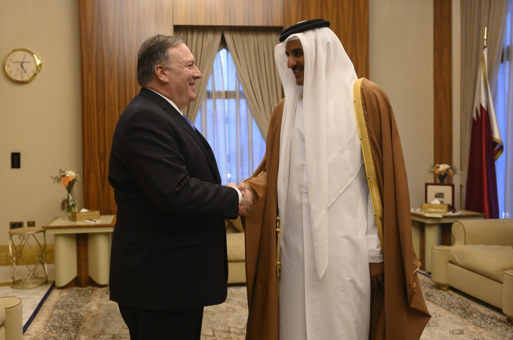 U.S. Secretary of State Mike Pompeo, left, shakes hands with the Qatari Emir Tamim bin Hamad Al Thani, at the Sea Palace, in Doha, Qatar, Sunday, Jan.