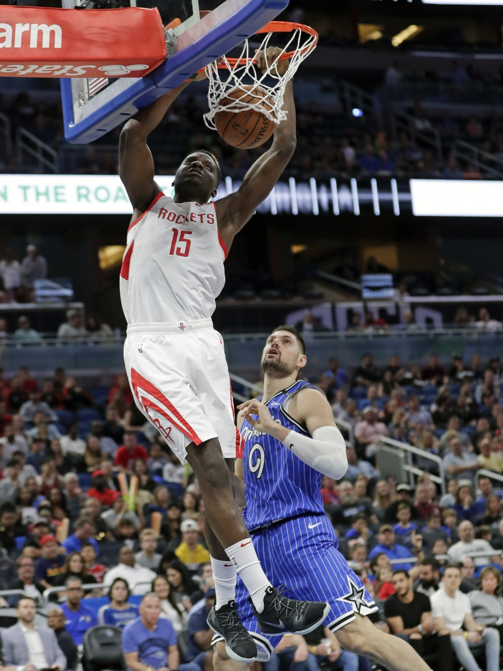 Houston Rockets' Clint Capela (15) dunks over Orlando Magic's Nikola Vucevic (9) during the first half of an NBA basketball game, Sunday, Jan. 13, 201