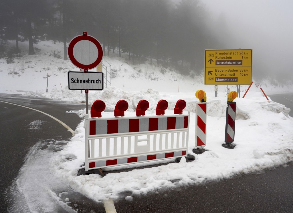 A road in the Black Forest is closed due to snow in Seebach, southern Germany, Monday, Jan. 14, 2019. Authorities in parts of Austria, Germany and Swi