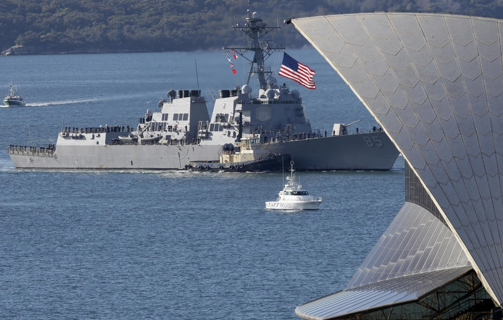 FILE - In this July 4, 2011, file photo, the U.S. guided-missile destroyer USS McCampbell (DDG 85) sails past the Opera House in Sydney, Australia to