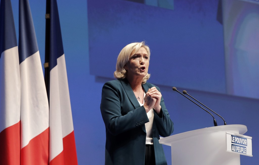 French far-right leader Marine le Pen delivers her speech during a campaign meeting in Paris, Sunday, Jan. 13, 2019. Le Pen's French far right party N