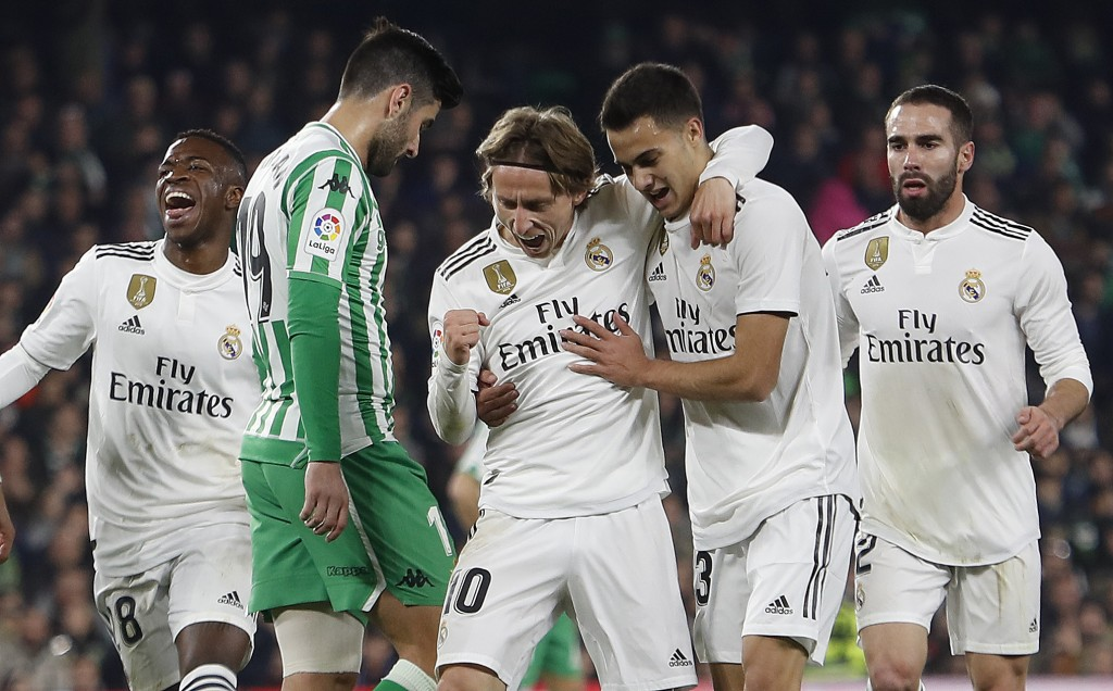 Real Madrid's Modric, center, celebrates after scoring against Betis during La Liga soccer match between Betis and Real Madrid at the Villamarin stadi