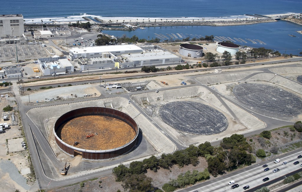FILE - The Sept. 4, 2015 file photo shows the Carlsbad, Calif. desalination plant which borders Interstate 5 on one side and the Pacific Ocean on the