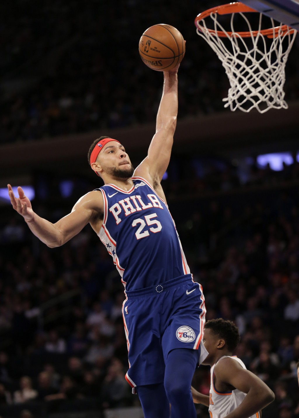 Philadelphia 76ers' Ben Simmons jumps to the basket during the first half of an NBA basketball game against the New York Knicks, Sunday, Jan. 13, 2019
