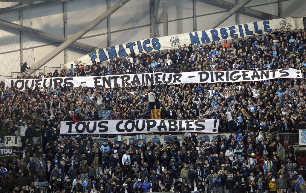"""Marseille supporters display banners reading """"Players,-coach- managers: all guilty"""" after the bad results of their team during the League One soccer m"""