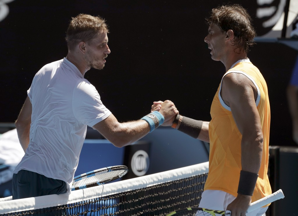 Spain's Rafael Nadal, right, is congratulated by Australia's James Duckworth after winning their first round match at the Australian Open tennis champ