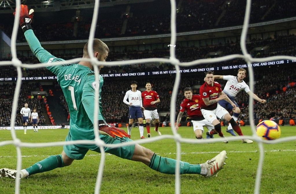 Manchester United goalkeeper David de Gea saves on a shot by Tottenham's Harry Kane, right, during the English Premier League soccer match between Tot